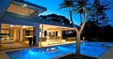 gremmo homes pool of glenhaven home at night
