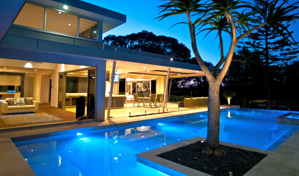 gremmo homes pool design at night