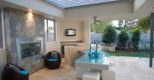 gremmo homes brighton drive display outdoor living area with fire place