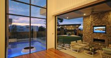 gremmo homes display home indoor outdoor living at sunset