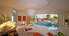 gremmo homes living room orange accents design look out to pool