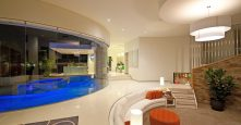 gremmo homes Stonybrook at night indoor design see outdoor pool